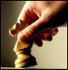 Hand-moving-chess-piece